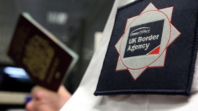 UK Border Agency officer at Passport Control