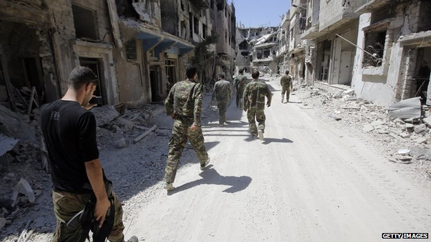 Syrian government forces in Homs in July 2013