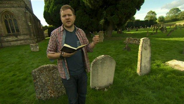 Poet Mark Grist reading his poem in a graveyard