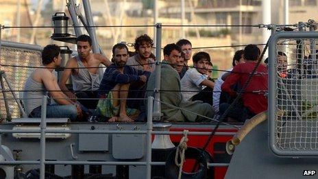 Rescued migrants arriving in Valletta, Malta, 12 October 2013