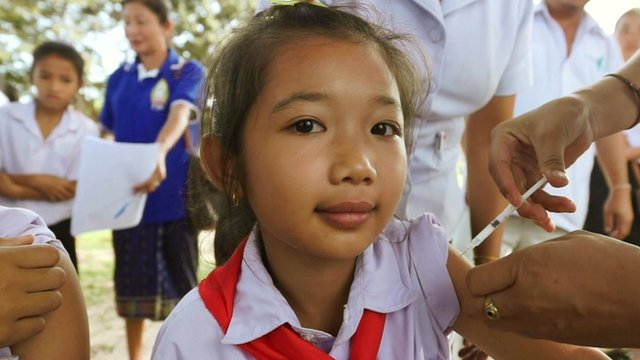 A young girl in Laos, South East Asia, being injected with the HPV vaccine