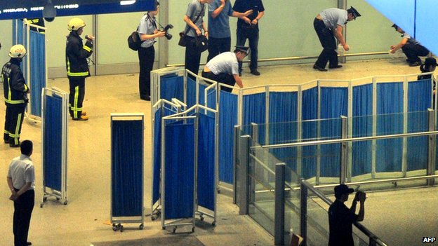 Chinese security personnel investigate the scene