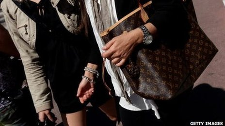 A woman in Cannes with a Louis Vuitton bad
