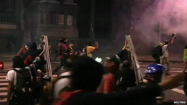 Some protesters used metal boards from the front of shops to charge towards police