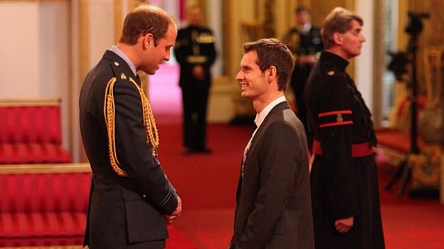 Wimbledon champion Andy Murray receives his Officer of the Order of the British Empire (OBE) medal from the Duke of Cambridge