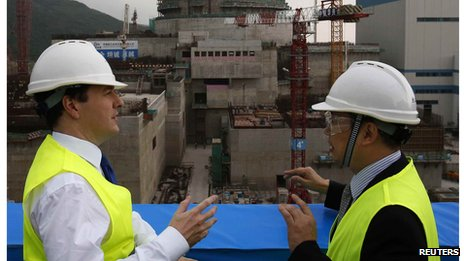 George Osborne chats with Taishan Nuclear Power General Manager Guo in front of nuclear reactor under construction in Taishan (17 Oct 2013)