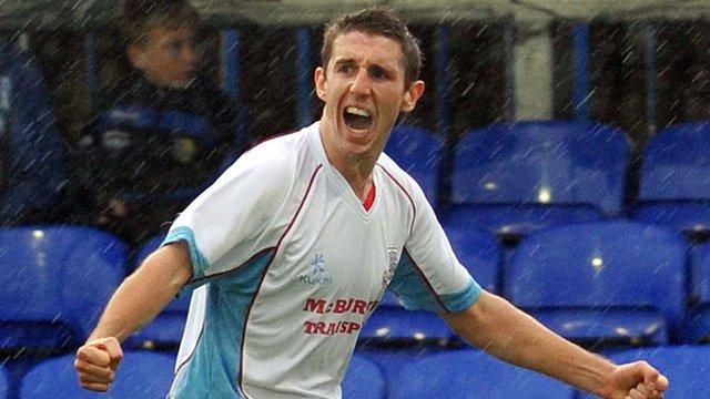 Gary Thompson celebrates scoring for Ballymena against Dungannon