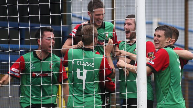 Glentoran players celebrate victory over Coleraine at the Coleraine Showgrounds