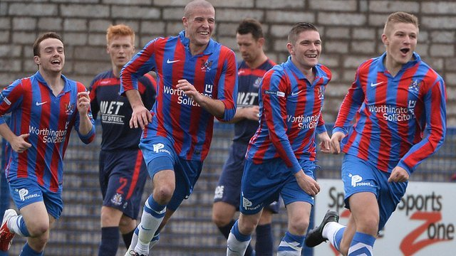 Ards players celebrate beating Portadown 3-1 at Clandeboye Park