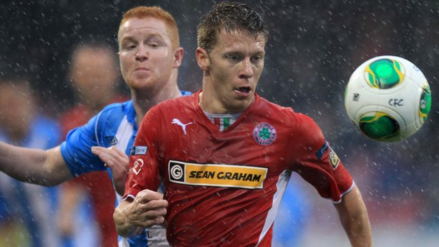 Match action from Cliftonville against Warrenpoint at Solitude