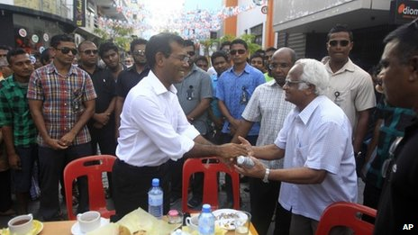 Mr Nasheed (centre) shakes hands with a supporter during a protest in Male. Photo: 19 October 2013