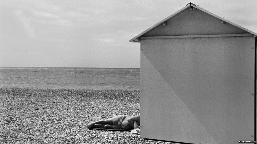 Man resting on a beach in France