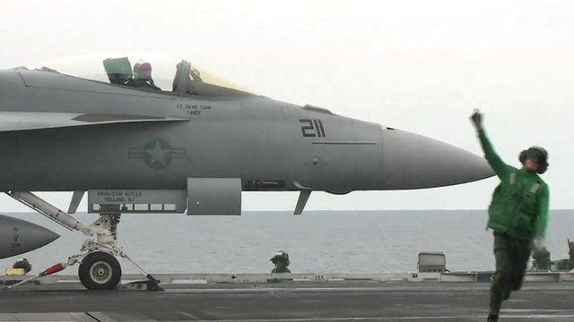 F-18 jet on aircraft carrier