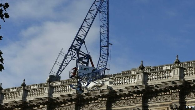 A crane on the roof of the Cabinet Office in London has collapsed