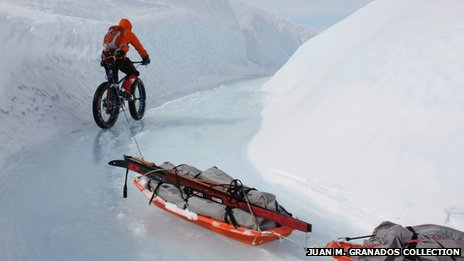 Bike pulling sledges in Greenland