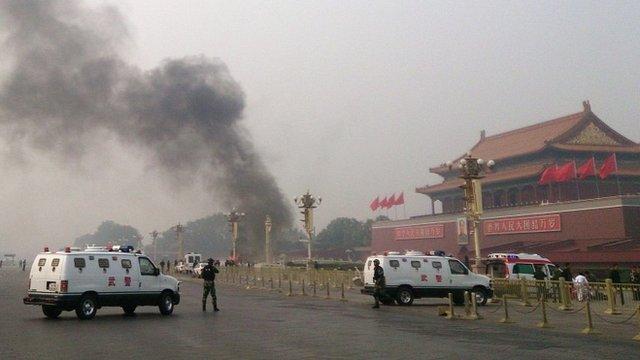 Smoke rises after the crash