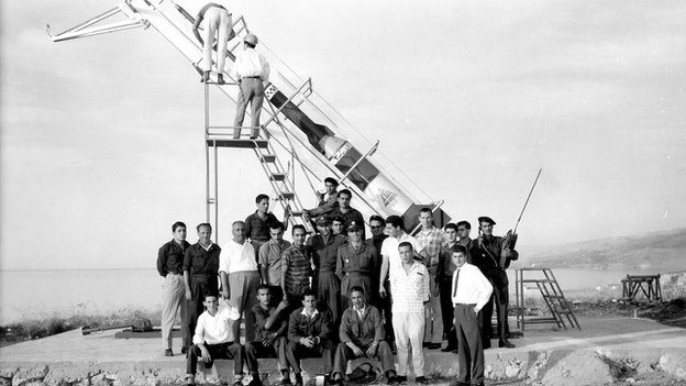 Students stand in front of the Cedar III rocket in 1962