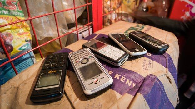 Mobile phones on money kiosk