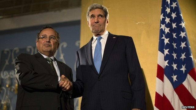 """US Secretary of State John Kerry shakes hands with Egypt""""s Foreign Minister Nabil Fahmy"""