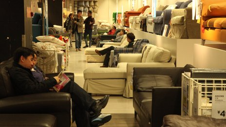 People sit on sofas in Ikea