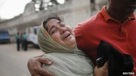 A relative of a prisoner cries after the verdict for a 2009 mutiny is announced (5 November 2013)