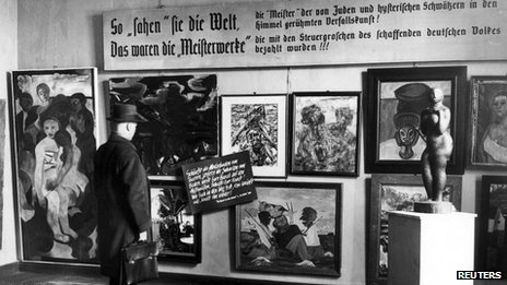 Man looking at pictures in the Degenerate Art Exhibition