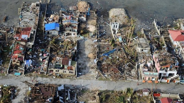 Destroyed houses hit by Typhoon Haiyan in the town of Guiuan in Eastern Samar province, central Philippines on 11 November 2013