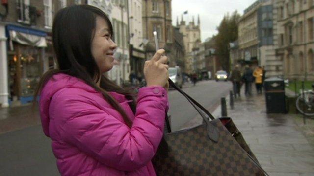 Chinese tourist taking a photo