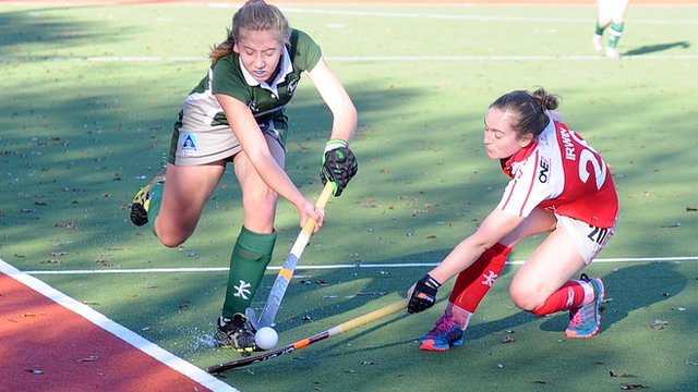 Randalstown's Alex Ogilby is tackled by Pegasus opponent Grace Irwin