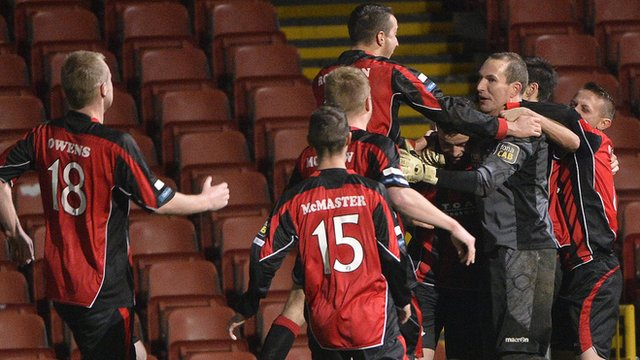 Crusaders celebrate their penalty shoot-out win over Linfield in the League Cup quarter-finals