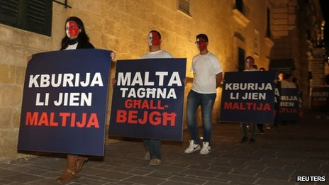 Protesters in Malta opposing new citizenship scheme, 12 Nov 13