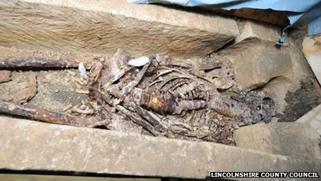 Skeleton in sarcophagus