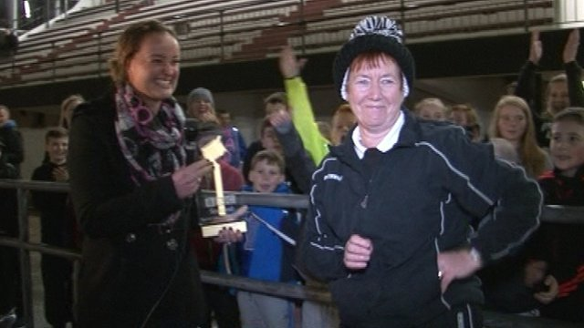 Janice Hendrie (right) is presented the BBC Scotland Sports Unsung Hero Award by Susan Egglestaff