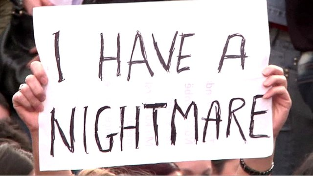 A protester holds sign reading 'I have a nightmare'