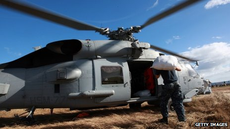 US soldiers load relief supplies into a navy seahawk helicopter on 16 November in Tacloban
