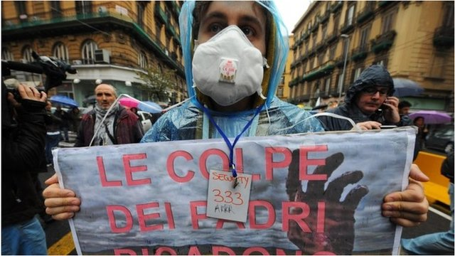 A protester marches in Naples