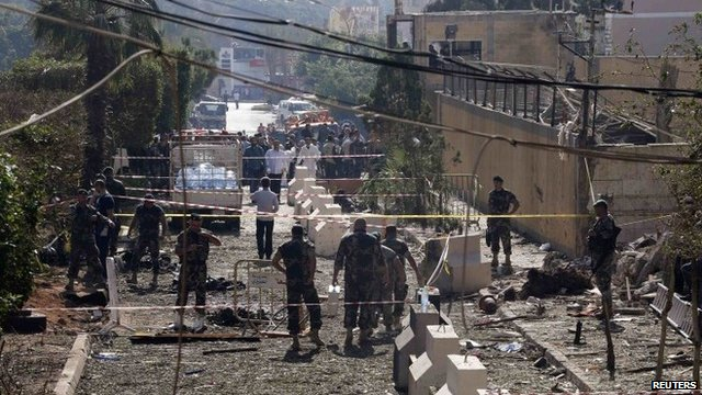 Lebanese Army soldiers inspect the site of the explosion
