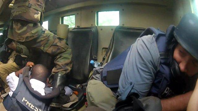 Mark Doyle in armoured vehicle