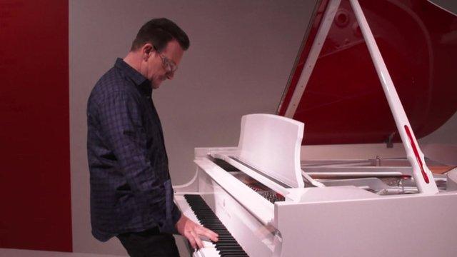 Bono playing a Steinway