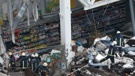 Rescuers in among the rubble of the collapsed supermarket in Riga on 23 November 2013