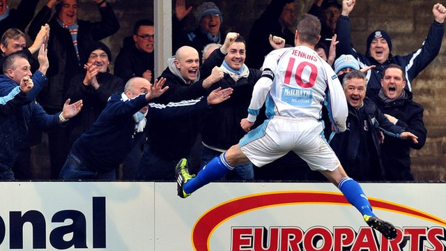 Allan Jenkins celebrates with the fans after scoring to put Ballymena 2-0 up against Warrenpoint