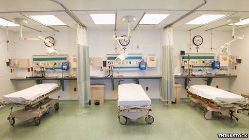 three hospital beds in a row