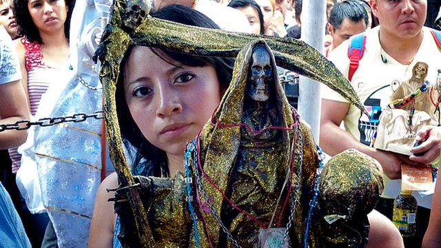 Devotee prays to Santa Muerte
