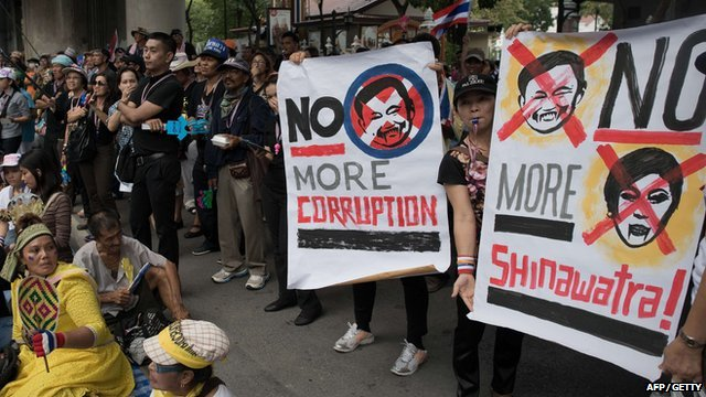 Protesters rally in front of the national police headquarters in Bangkok