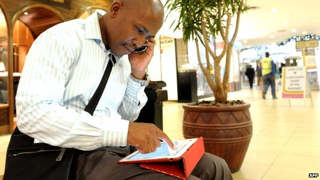 A man using a tablet in November 2012 in Johannesburg, South Africa