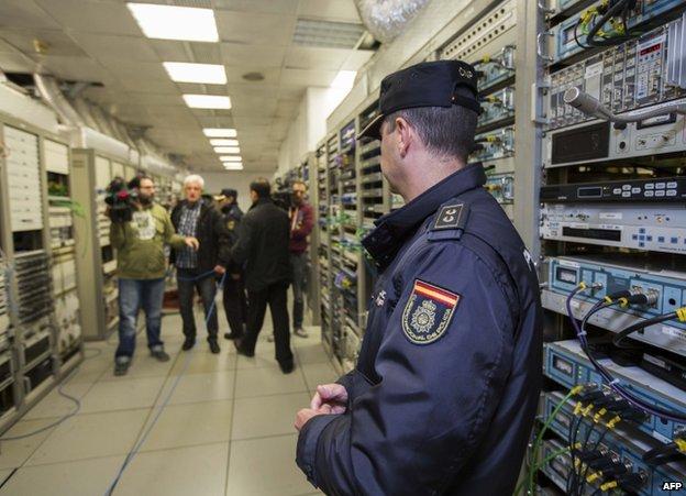 Police inside RTVV in Valencia, Spain, 29 November