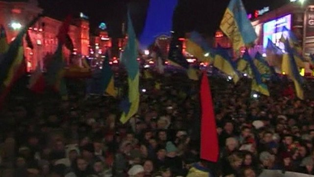 Protesters waving flags in Kiev's European Square