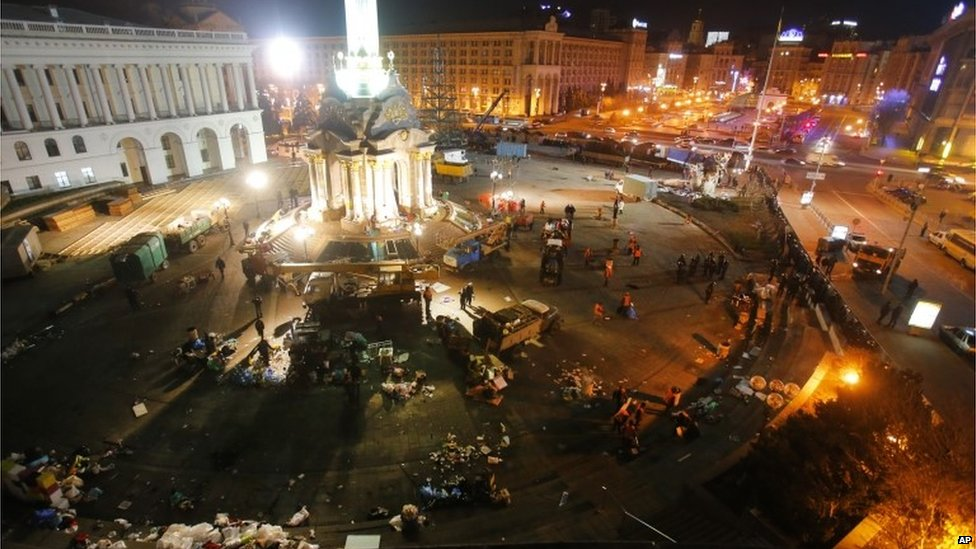 Workers clean the Independence Square.