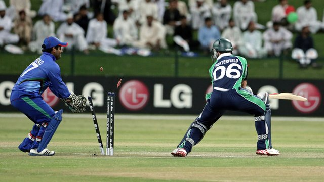 William Porterfield is bowled out in the final against Afghanistan