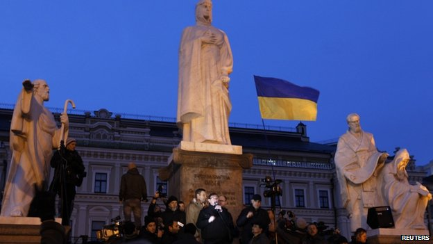 Opposition leaders (C) address people at the foot of the monument to Grand Princess Olga during a rally in Kiev